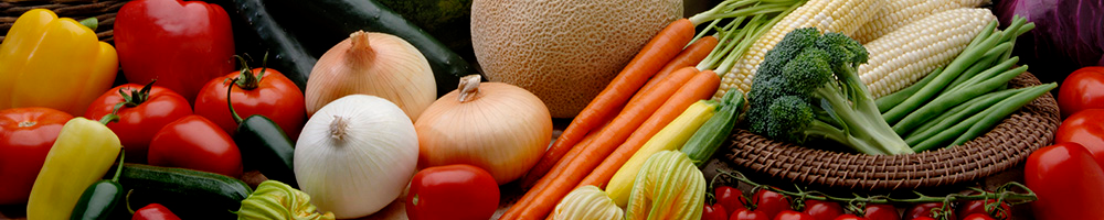 A large assortment of vegetables; including peppers, tomatoes, cucumbers, onions, melons, carrots, squash, broccoli, green beans, and sweet corn.